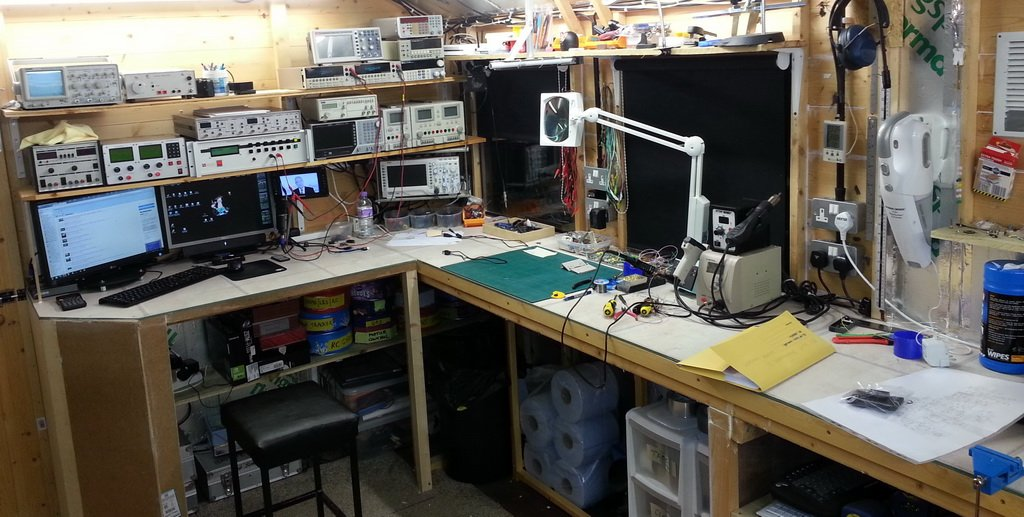 electrical engineer's electronics lab work bench with oscilloscope
